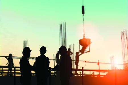 Silhouette engineer standing orders for construction crews to work safely on high ground over blurred natural background sunset pastel. heavy industry and safety at work concept. 版權商用圖片 - 81958580