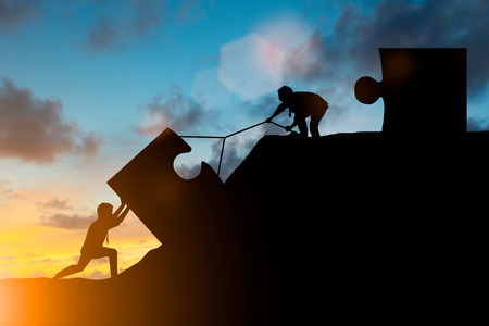 Silhouette team business helps to systematically patience hard work and the pressure to reach the finish line over blurred natural. Motivate employee growth concept. jigsaw