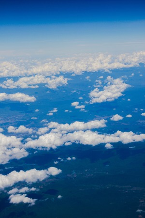 Cumulus cloud and field from airplane view