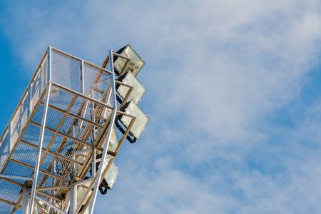 hight tech: Pillar spotlights high on the blue sky