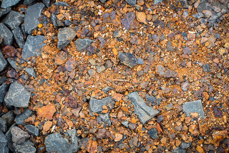 kinky: Pieces of rust on the pavement, abstract texture top view. Stock Photo