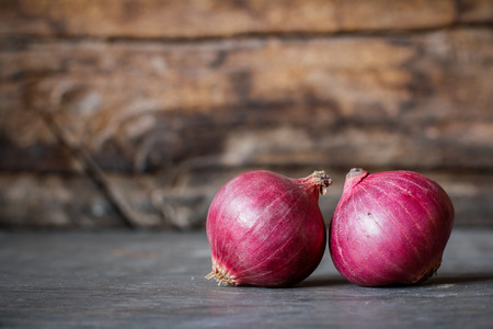 Close-up of fresh red onions on a wooden background Reklamní fotografie