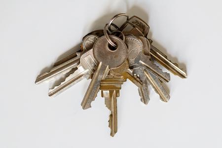 Many keys on white background Stock Photo