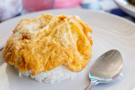 Minced pork omelet over rice