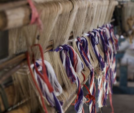 choise: Close up set of colorful wool threads, measuring tape and bobbin. fabrics material