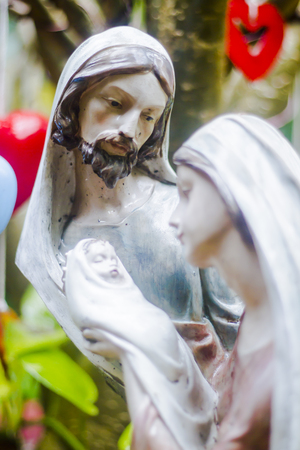 Holy Family and Jesus. Jesus, Mary, Joseph and little angel in garden concept Holy Family. background, focus Joseph.