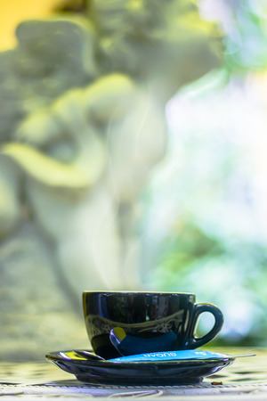 Hot coffee in the cup on morning background. Stock Photo