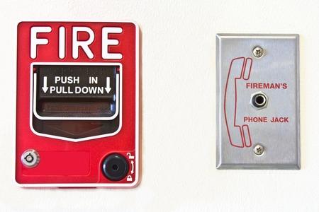 Fire alarm switch  white background   Archivio Fotografico