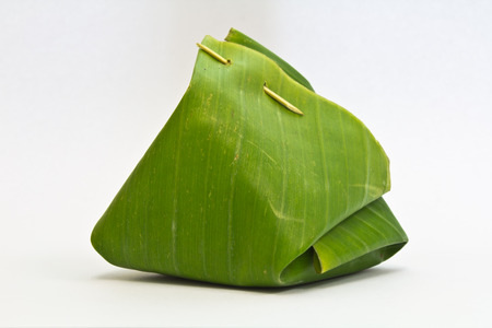 Thai dessert, Sticky rice with steamed custard, wrapped in banana leaves