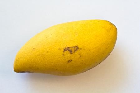 Ripe mango on white