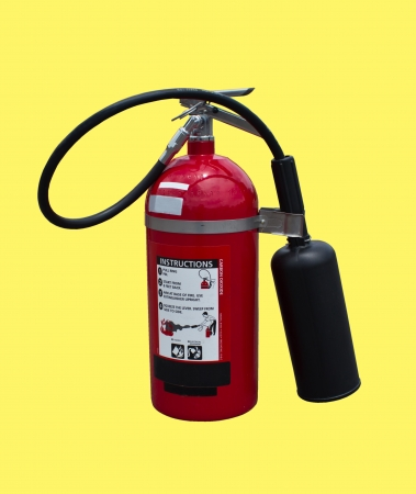 extinguishers: Fire extinguishers carbon dioxide on yellow background  Stock Photo