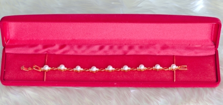 Silver pearl earrings and red velvet box   Stock Photo