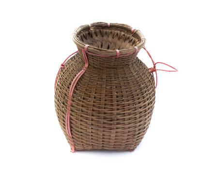 Fishing creel, bamboo basket put the fish isolated on white background