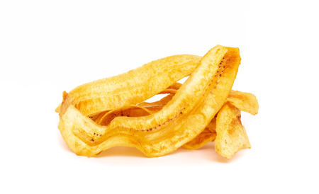 sweet banana crisps so delicious on white background Stock Photo