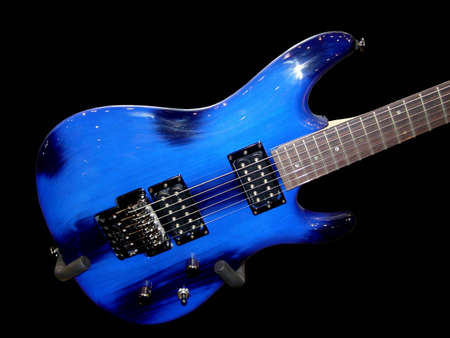 melodious: multicolor electric guitar on the Black Background