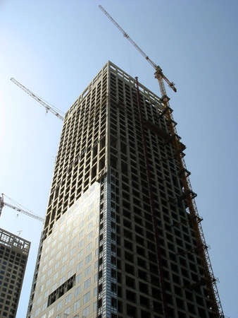 altitude crane on a building site in china                                photo