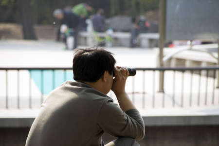 far away look: man with binoculars