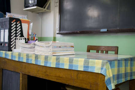 schoolroom: A teachers desk and a chalkboard in an schoolroom