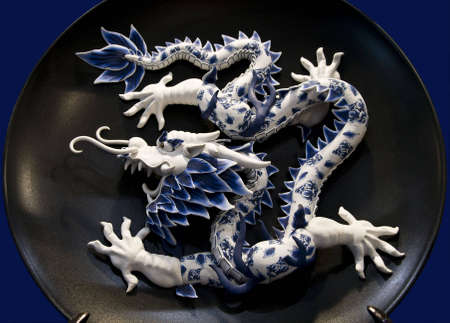 godliness: Chinese dragon in porcelain dish background Stock Photo