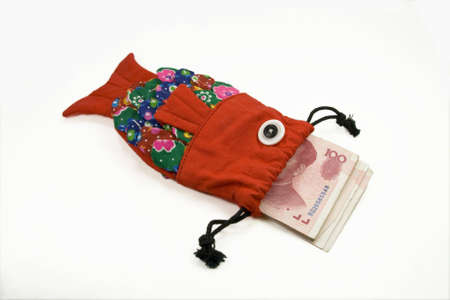 The traditional fish shape purse with money photo