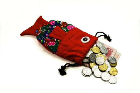 The traditional fish shape purse with money