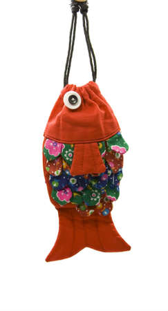 The traditional fish shape purses on the white  photo