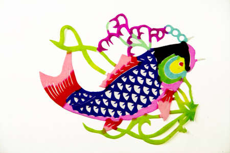 kirigami: The traditional paper cut fish on the white