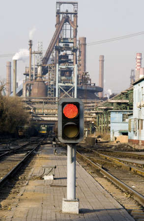 Railway signal gantry showing a red light Stock Photo - 2207403