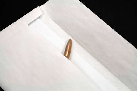 A bullet in an envelope inside photo