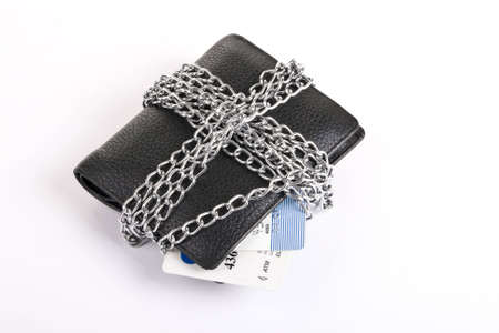 wallet and credit card tied with chain on white background