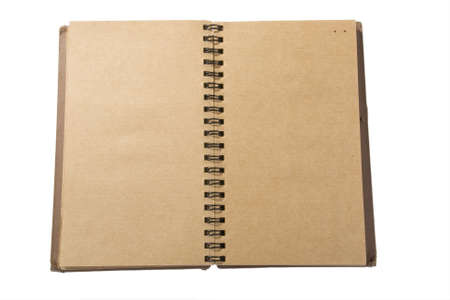 old spiral notebook with white background photo