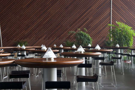 empty cafe interior with tables on the lamps