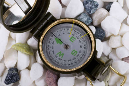 a compass on the colorful pebbles photo