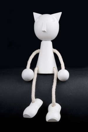 white puppet on black background Stock Photo - 3268043