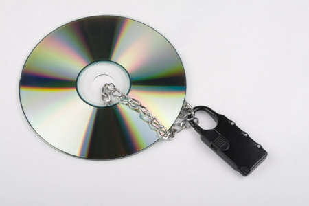 The Compact disk is locked on white background photo