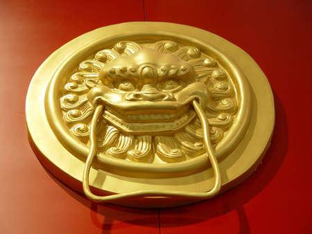 Antique lion head door knob                                photo