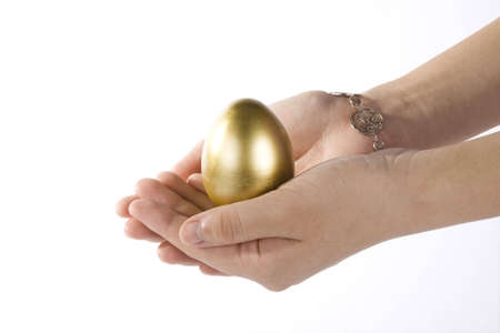 hands holding a golden egg on white background,concept of hatch Money Stock Photo - 3348830