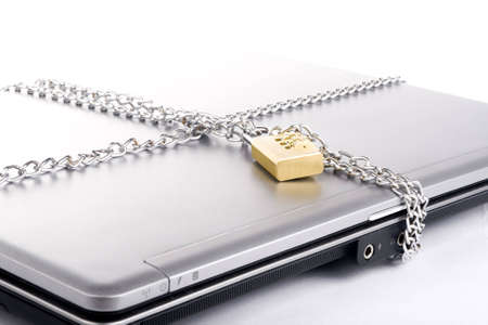 Laptop with chains and combination padlock isolated on white Stock Photo - 3565085