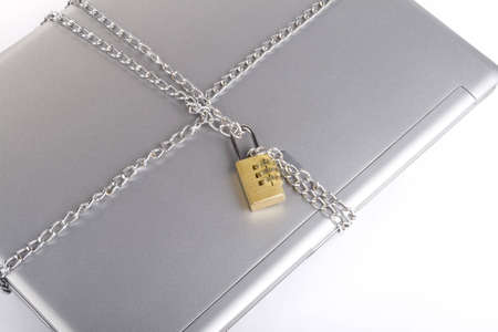 Laptop with chains and combination padlock isolated on white Stock Photo - 3565092