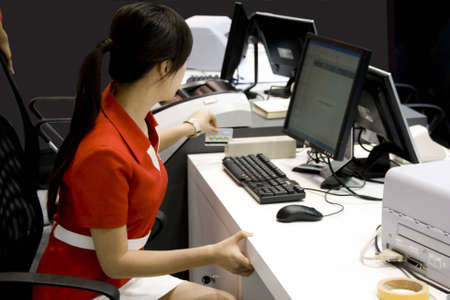 Young business woman at work in bank