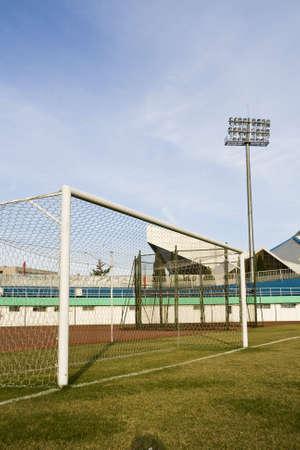 goalpost: Soccer goalpost in empty football stadium Stock Photo