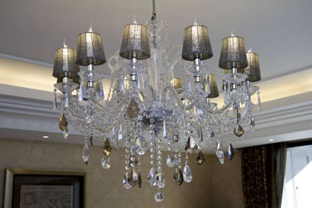 Beautiful and dear modern chandelier in living room photo