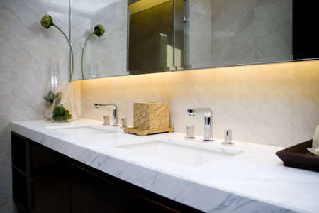 washroom: modern bathroom with sinks and mirror Stock Photo