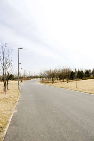 empty asphalt road in park in china photo