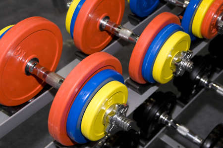 Closeup of colorful dumbbells in a gym or studio photo