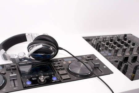 audio mixer: DJs mixer and headphones on a white background Stock Photo