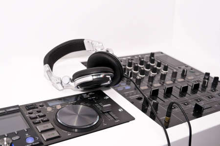DJs mixer and headphones on a white background Stock Photo