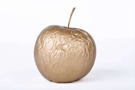 contracted: contracted golden dry apple against white background