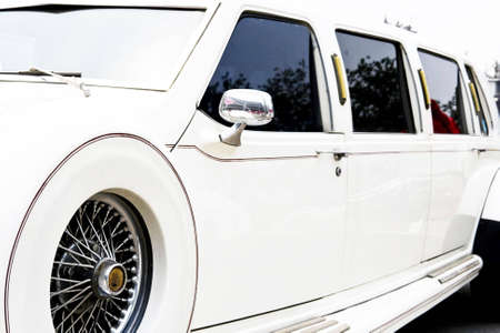 spoked: Long white limousine with spoked wheels