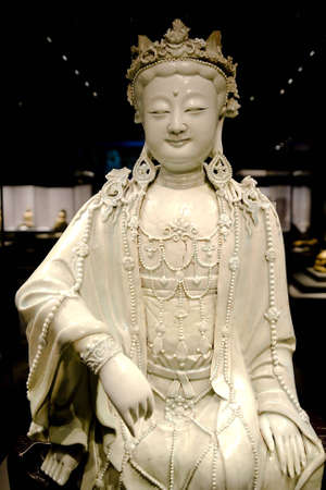 statue of white-glazed Avalokitesvara in the china photo